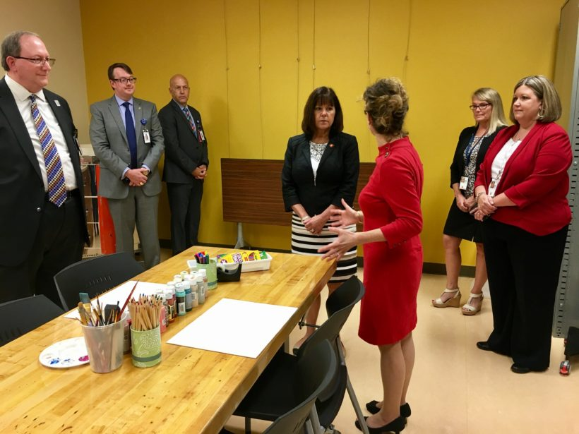 Mrs. Pence taking a look at the new art therapy space at James A. Haley Veterans' Hospital, where the Creative Forces art therapist will work with veterans.