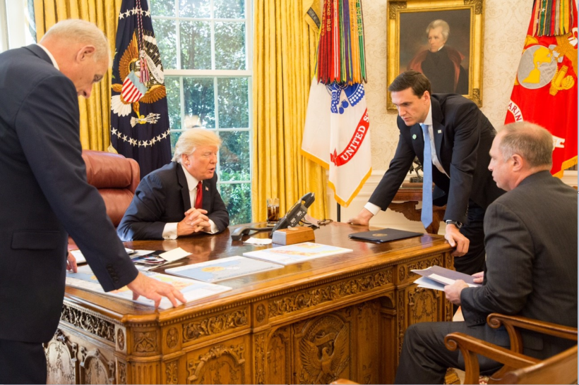 """President Donald J. Trump participates a Hurricane Irma briefing call with FEMA Administrator William """"Brock"""" Long, Monday, Sept. 11, 2017, joined by White House Chief of Staff Gen. John Kelly, left; Homeland Security and Counter Terrorism Adviser Thomas Bossert, right, and Deputy Homeland Security Adviser John J. Daly, seated, in the Oval Office at the White House in Washington, D.C."""