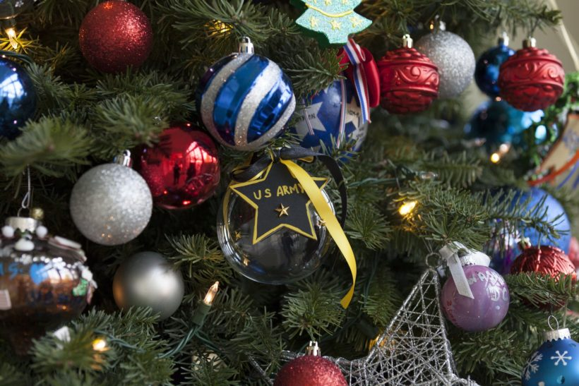 Ornaments created by military families hang on the Christmas tree in the sunroom.