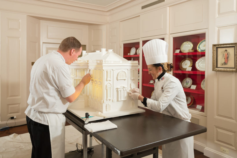 White House pastry Chef Susan Morrison, right, and pastry assistant Brandon Blomquist, craft detailed designs on a White House Christmas creation, Wednesday, November 22, 2017, at the White House in Washington, D.C.
