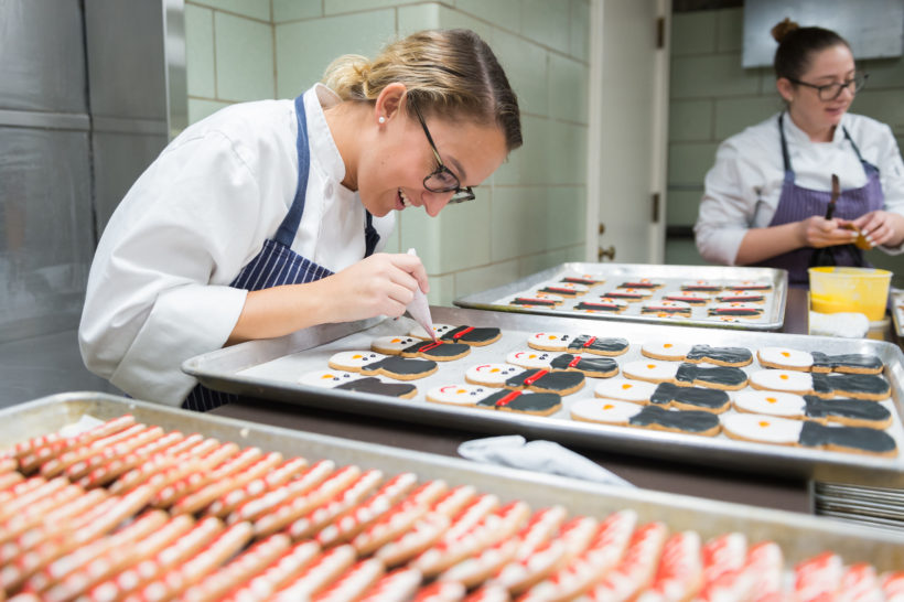 White House pastry decorator Kim Schaeffer puts the finishing touches on some of the many Christmas cookies for the White House Christmas festivities, Wednesday, November 22, 2017, in Washington, D.C.