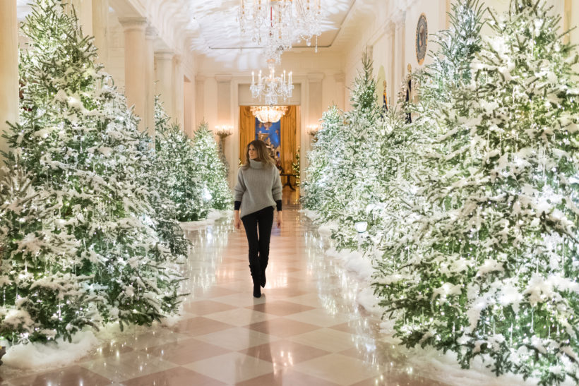 First Lady Melania Trump examines the lighting decorations along the State Floor of the White House, Sunday evening, November 26, 2017, in Washington, D.C.