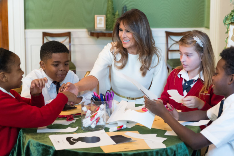 First Lady Melania Trump participates in an arts and crafts project with schoolchildren from Joint Base Andrews, Maryland, Monday, November 27, 2017, during their visit to the White House Christmas preview event, at the White House in Washington, D.C.