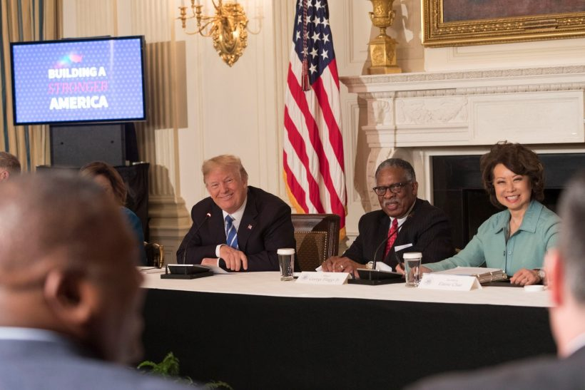 President Donald J. Trump, seated next Mayor George Flaggs Jr. of Vicksburg, MS, and U.S. Secretary of Transportation Elaine Chao, right, listens during discussions at the infrastructure initiative meeting with state and local officials, to unveil a $1.5 trillion infrastructure proposal, Monday, February 12, 2018, in the State Dining Room at the White House in Washington, D.C. U.S. Secretary of Transportation Elaine Chao is seen at right. (Official White House Photo by Shealah Craighead)