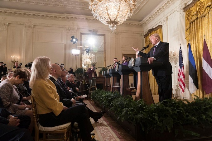 President Donald J. Trump, joined by Baltic State Presidents, from left to right, Raimonds Vejonis of Latvia; Kersti Kaljulaid of Estonia and Dalia Grybauskaite of Lithuania, gestures as he addresses a joint press conference in the East Room at the White House, Tuesday, April 3, 2018, in Washington, D.C.