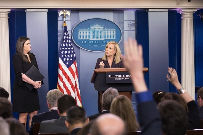 U.S. Secretary of Homeland Security Kirstjen Nielsen answers questions from reporters, Wednesday, April 4, 2018, during her briefing on border security in the James S. Brady Press Briefing Room at the White House in Washington, D.C. White House Press Secretary Sarah Huckabee Sanders is seen at left.