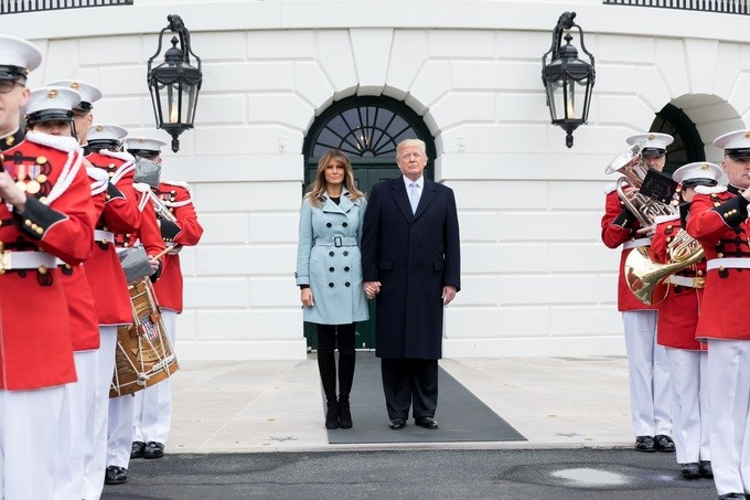 President Donald J. Trump and First Lady Melania Trump, walk out toward the South Lawn of the White House, to join in the festivities of the White House Easter Egg Roll, Monday, April 2, 2018, in Washington, D.C.