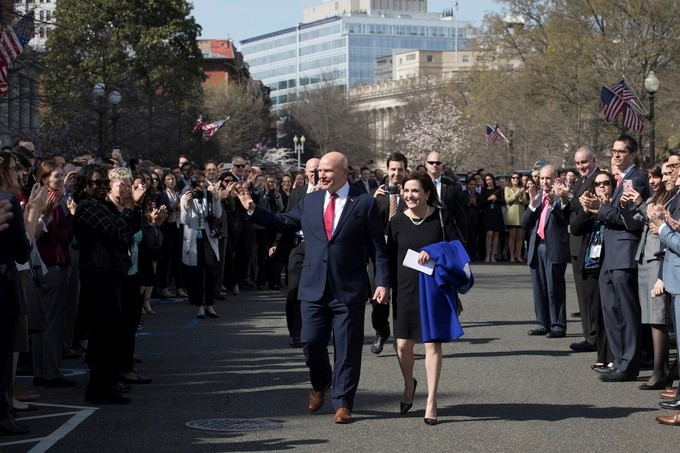 National Security Adviser Lt. Gen. H.R. McMaster, joined by his wife, Kathleen, acknowledges the applause of White House staff, Friday, April 6, 2018, outside the West Wing at the White House, gathered to bid farewell to McMaster, who tendered his resignation from his post last month.