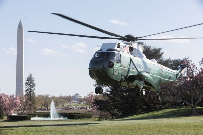 Marine One, with President Donald J. Trump aboard, prepares to land on the South Lawn of the White House, Thursday, April 5, 2018, against a backdrop of the Washington Monument and the Jefferson Memorial, as President Trump returns from attending a tax reform event in West Virginia.