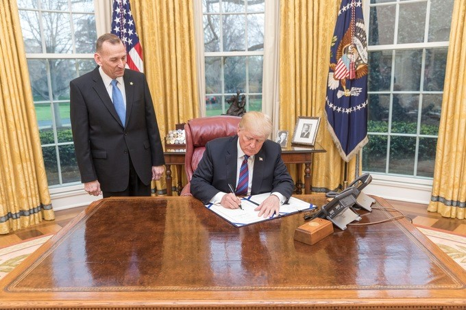 "President Donald J. Trump, joined by the Randolph D. ""Tex"" Alles, Director of the U.S. Secret Service, signs H.R.3731-the U.S. Secret Service Retention Act of 2018, in the Oval Office at the White House, Tuesday, April 3, 2018, in Washington, D.C. The enrolled bill removes certain limits on overtime pay earned by employees of the U.S. Secret Service, who either provide protective services in calendar year of 2017 or will provide them in 2018."