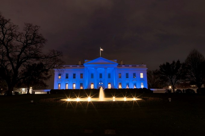 Blue light illuminates the North Portico of the White House, Monday evening, April 2, 2018, in recognition of World Autism Awareness Day 2018.