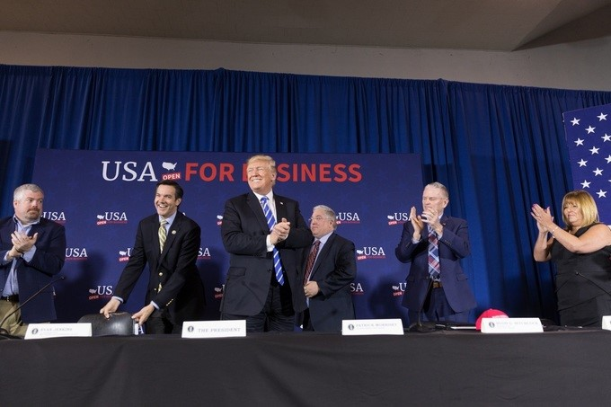 President Donald J. Trump is applauded at the conclusion of a roundtable discussion on tax reform, at the White Sulphur Springs Civic Center, Thursday, April 5, 2018, in White Sulphur Springs, West Virginia.