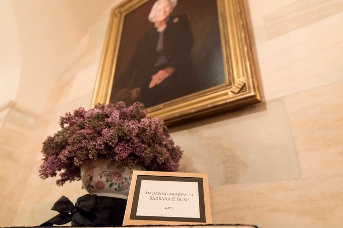 A remembrance display at the portrait of former First Lady Barbara Bush in the Center Hall at the White House in Washington, D.C., is seen Wednesday, April 18, 2018, in memory of Mrs. Bush who passed away on Tuesday.