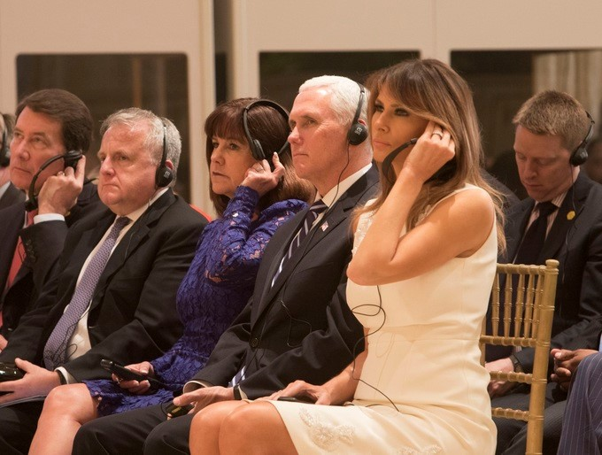 Vice President Mike Pence and Mrs. Karen Pence, joined by First Lady Melania Trump, listen on headsets at the joint press conference with President Donald J. Trump and Japanese Prime Minister Shinzo Abe, at Mar-a-Lago, Wednesday, April 18, 2018, in Palm Beach, Florida, addressing issues discussed during their two days of meetings.