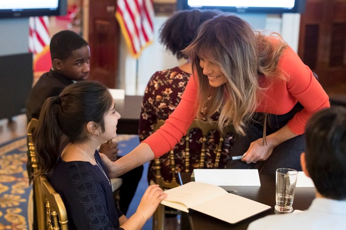 First Lady Melania Trump talks with eleven-year-old Leena Rasheed of Manassas, Virginia, in a listening session with students to discuss a wide range of issues facing today's youth, in the Blue Room at the White House, Monday, April 9, 2018, in Washington, D.C.