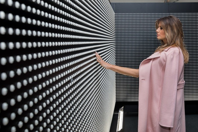 """First Lady Melania Trump views a wall featuring 22,000 white pills at the traveling opioid exhibit and memorial, """"Prescribed to Death"""", on the Ellipse, Monday, April 16, 2018, in Washington, D.C. Each pill features a face representing the 22,000 individuals who died in 2015 from opioid and fentanyl overdoses."""