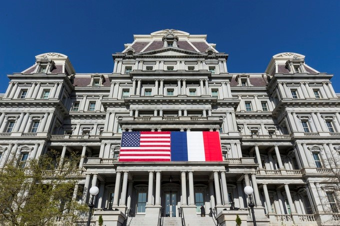 American and French flags are hung on the exterior of the Eisenhower Executive Office Building at the White House, Friday, April 20, 2018, in Washington, D.C. The flags are in preparation for the upcoming State Visit next week to the White House by French President Emmanuel Macron.