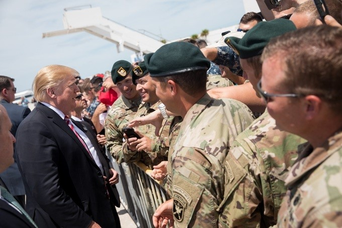 President Donald J. Trump is greeted by military personnel and their family members upon his arrival, Thursday, April 19, 2018, to Naval Air Station Key West in Key West, Florida.