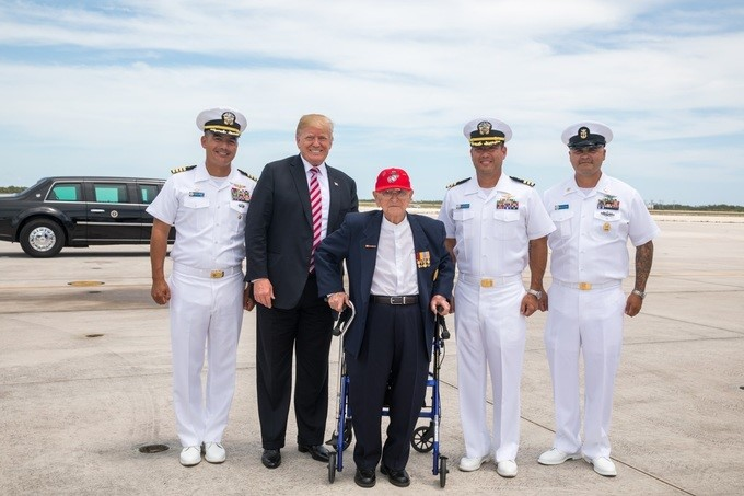 """President Donald J. Trump meets WWII U.S. Marine veteran George Skoko, Thursday, April 19, 2018, celebrating his 97th birthday and visiting with President Trump at the Naval Air Station Key West in Key West, Florida. Skoko served with the 1st Marine Division in the Pacific with then Col. Lewis """"Chesty"""" Puller in the battle of Peleliu in 1944."""