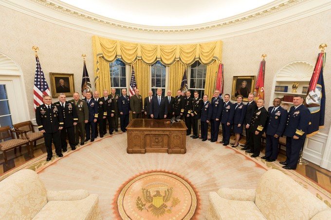 President Donald J. Trump, joined by Vice President Mike Pence, poses for a photo with senior military leaders, Monday evening, April 9, 2018, in the Oval Office at the White House in Washington, D.C.